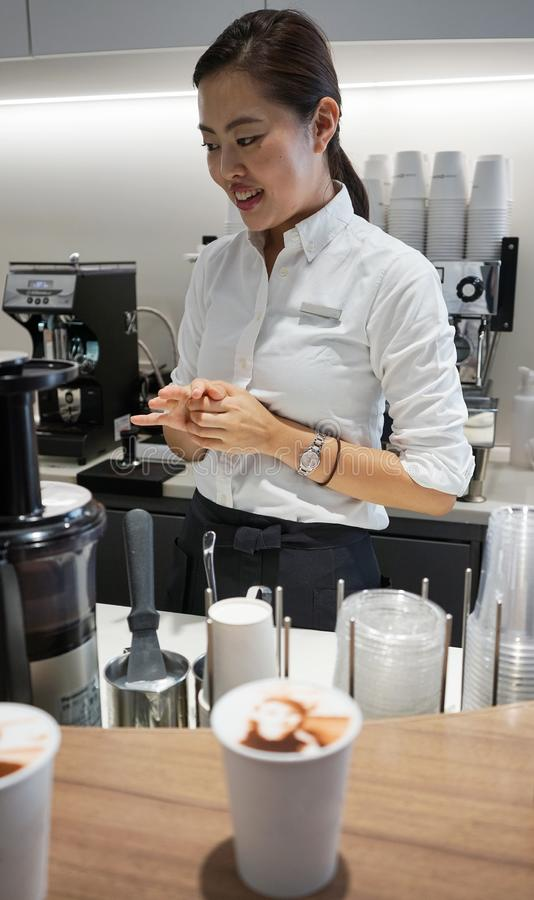 Portrait of pair of people on top of whipped cream topping cup coffee in famouse Ginza area city Tokyo, Japan. A beautiful asian stock images