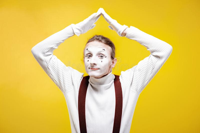 Portrait of a pantomime on the yellow background royalty free stock images