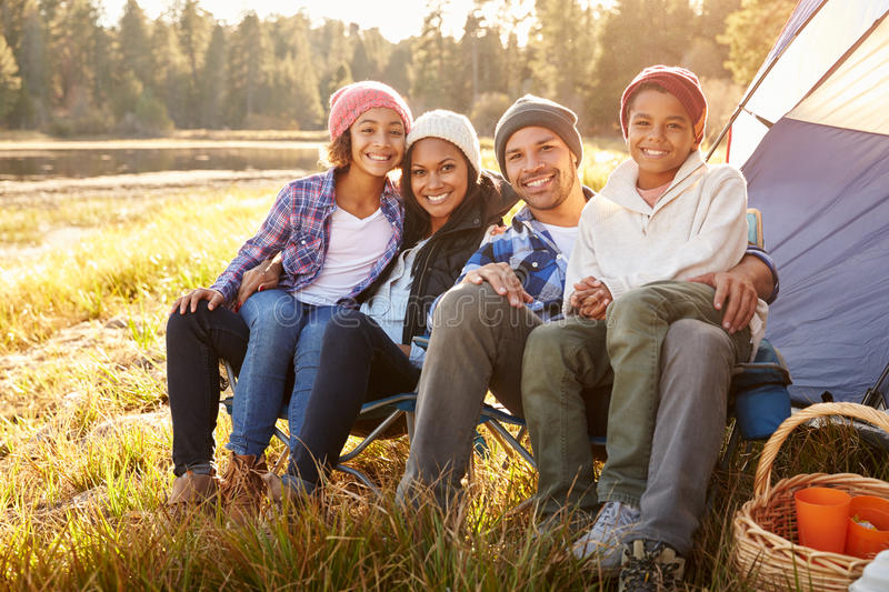 Portrait Of Parents With Children Camping By Lake royalty free stock photography