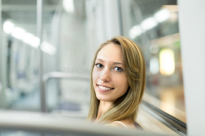 Portrait of passanger in train of metro. Portrait of a smiling female passanger in train of metro royalty free stock photos
