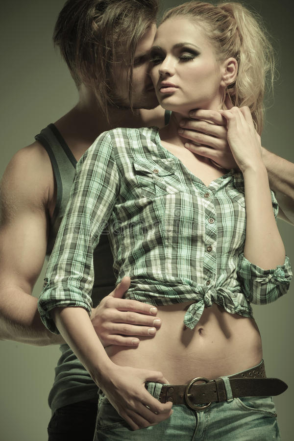 Portrait of a passionate young fashion couple stock photos