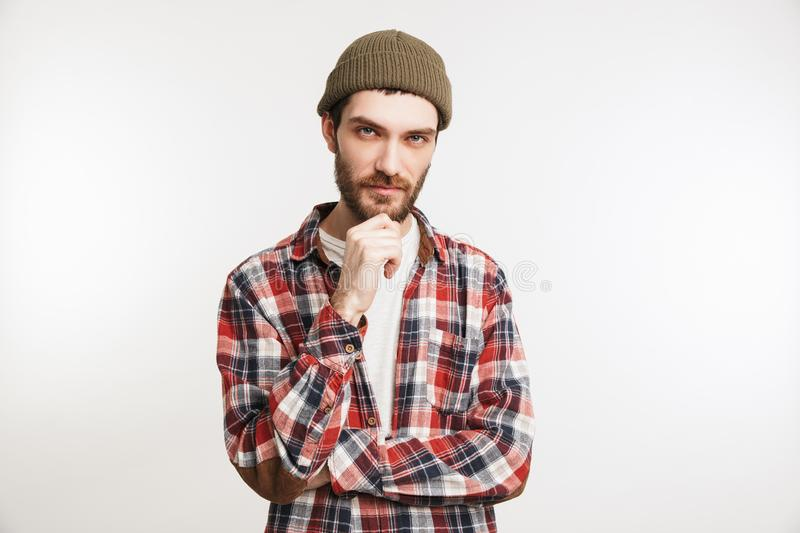 Portrait of a pensive bearded man in plaid shirt stock photography