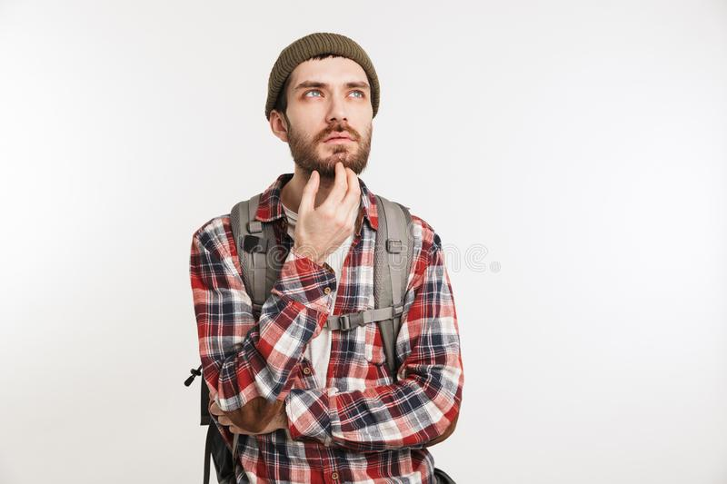 Portrait of a pensive bearded man in plaid shirt royalty free stock photography