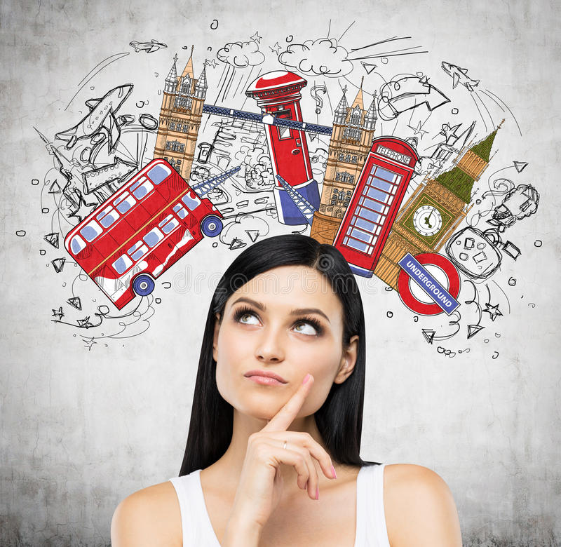 A portrait of a pensive brunette lady in a white tank top. Visiting of Great Britain concept. Concrete background with a colourful sketch of the most famous royalty free stock images