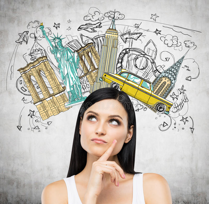 A portrait of a pensive brunette lady in a white tank top. Visiting of USA concept. Concrete background with a colourful sketch of the most famous places in royalty free stock images