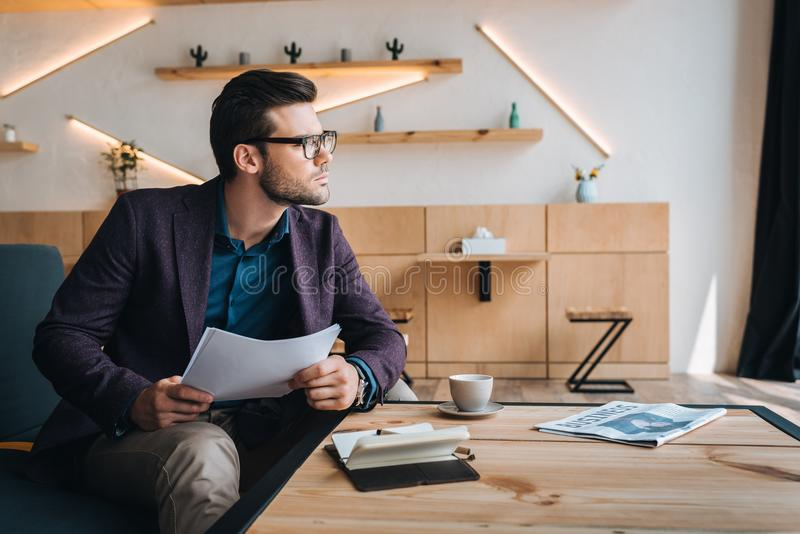 Businessman working with papers in cafe royalty free stock photos