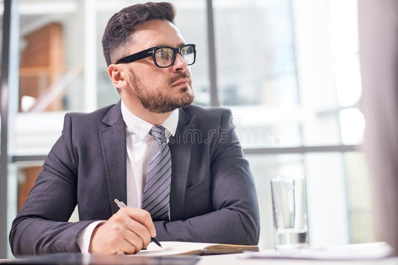 Portrait of Pensive Entrepreneur royalty free stock photography
