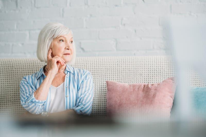 portrait of pensive grey hair woman stock images