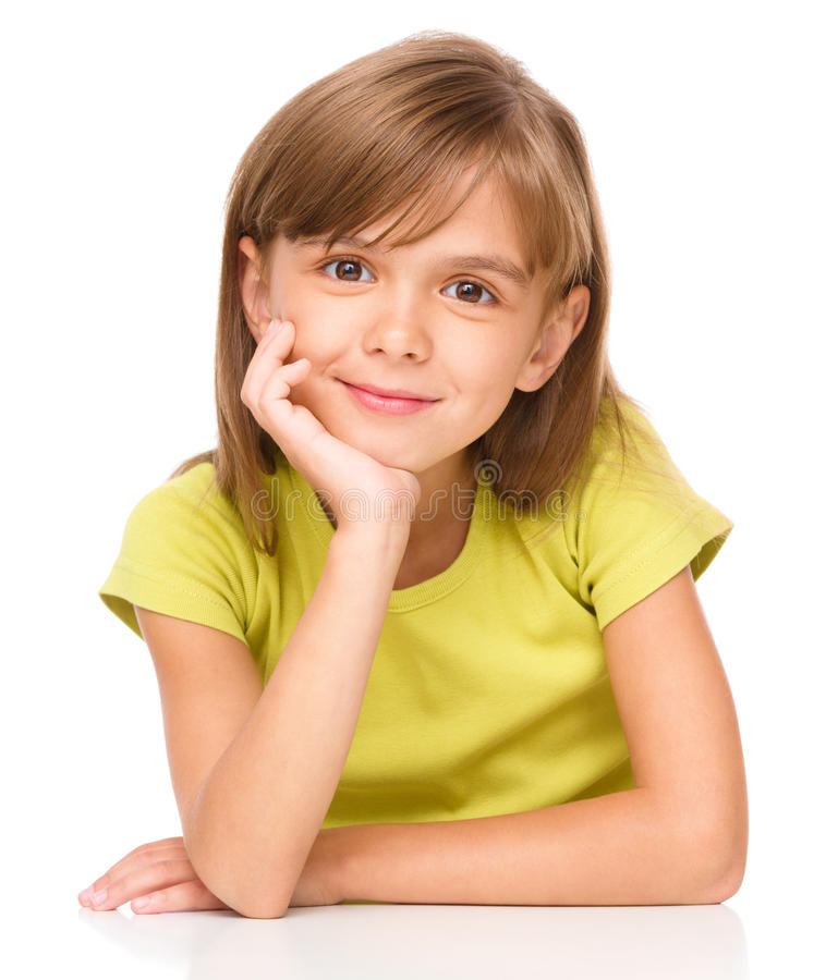 Portrait of a pensive little girl. Supporting her head with hand, isolated over white stock photography