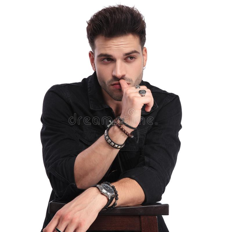 Portrait of pensive man in black clothes looking to side royalty free stock photography