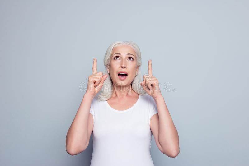 Portrait of perfect, nice, old, impressed woman in t-shirt demon royalty free stock photos