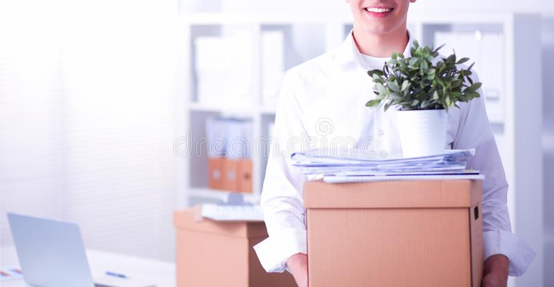 Portrait of a person with moving box and other stuff isolated on white. Portrait of a person with moving box and other stuff stock images