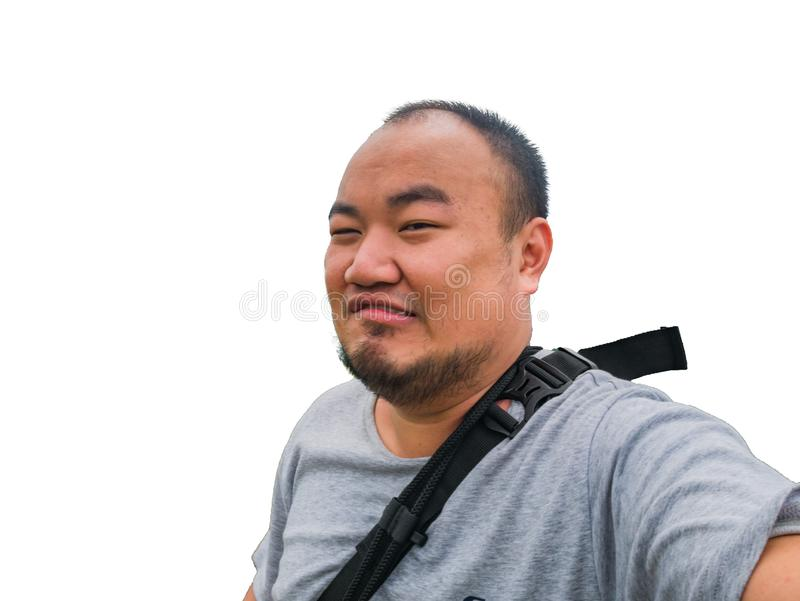 Portrait Photo of asian fat man make a cheeky face stock photos