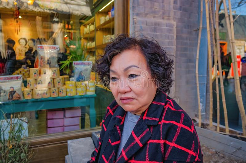 Portrait photo of Asian senior traveler women on Nanlouguxiang the Old Part area of the Beijing. Portrait photo of Asian senior traveler woman on Nanlouguxiang stock photos