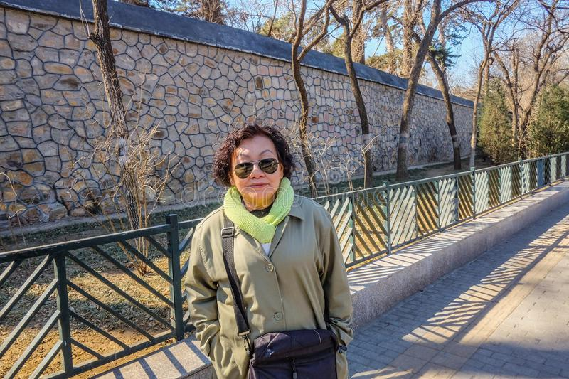 Portrait photo asian women traveler with Summer Palace wall in beijing stock photo