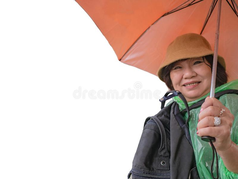 Portrait Photo of Beautiful Senior asian women backpecker Holding the umbrella royalty free stock photos