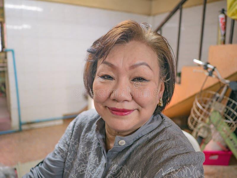 Portrait photo of Beauty Senior Asian women. Portrait photo of Beauty Senior Asian woman in the house royalty free stock images