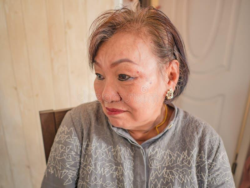 Portrait photo of Beauty Senior Asian women. Portrait photo of Beauty Senior Asian woman in the house stock image