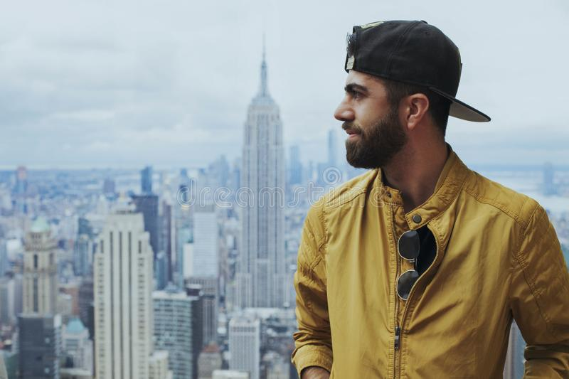 Portrait Photo of Man in Yellow Zip-up Jacket Near Empire State Building stock photography