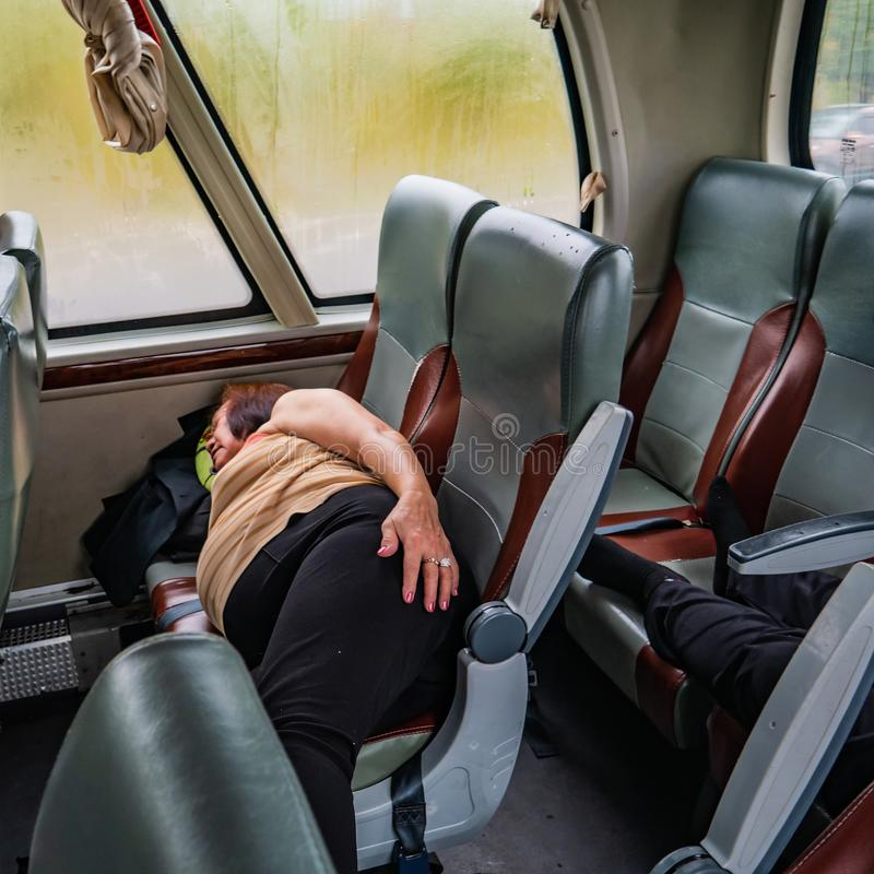 Portrait Photo of Senior asian womam Sleep on the Bus. When her vacation royalty free stock photos