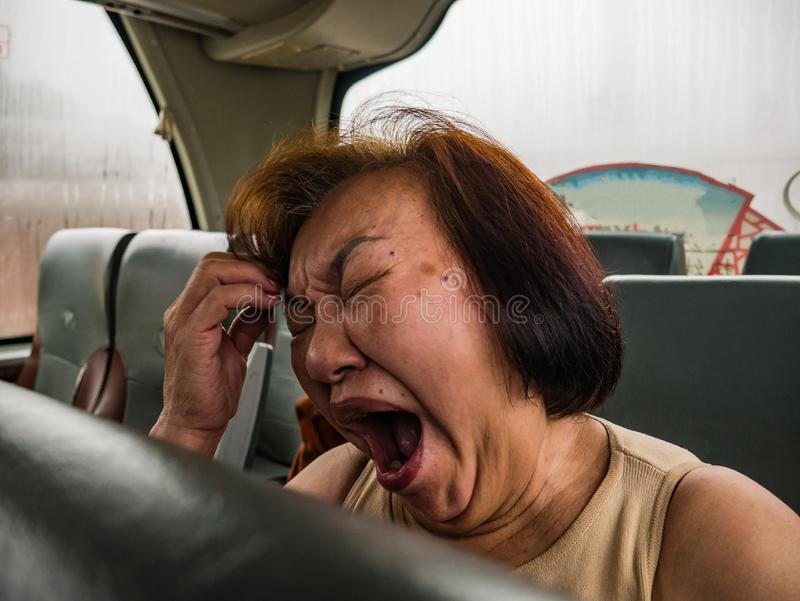 Portrait Photo of Senior asian womam Sleep on the Bus. Portrait Photo of Senior asian womam Yawn on the Bus when her vacation stock images