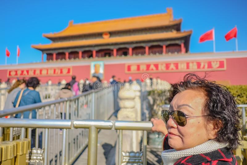 Portrait photo of Senior asian women with Forbidden Palace at beijing. Portrait photo of Senior asian woman with Forbidden Palace at beijing Capital City of royalty free stock photo