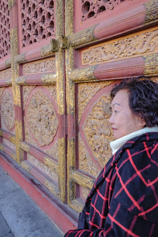 Portrait photo of Senior asian women in the Forbidden Palace Gate at beijing stock photo