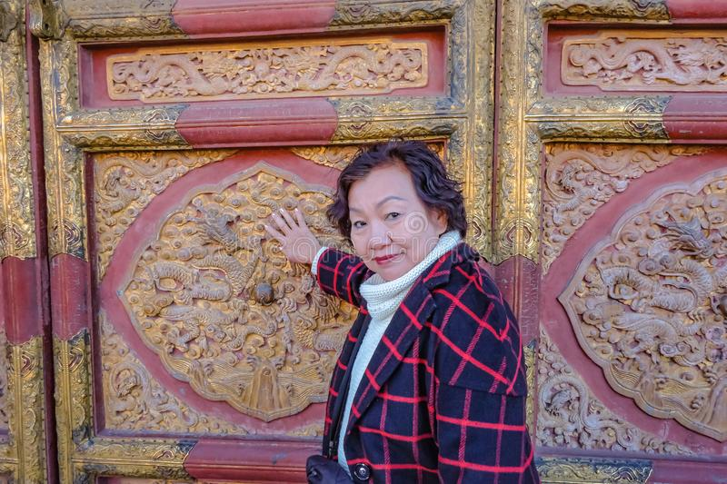 Portrait photo of Senior asian women in the Forbidden Palace Gate at beijing. Portrait photo of Senior asian woman in the Forbidden Palace Gate at beijing royalty free stock photo