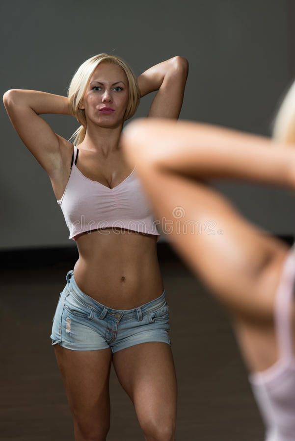 Portrait Of A Physically Woman In The Gym. Blonde Woman Posing In The Gym stock image