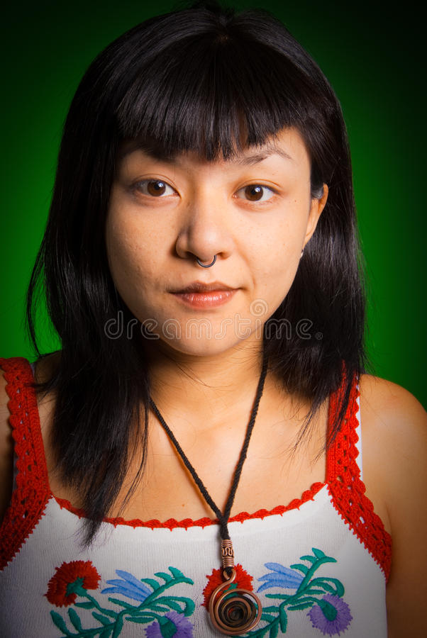 Portrait of a pierced Asiatic woman stock photography