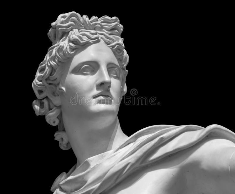 Portrait of a plaster statue of Apollo isolated on black stock photo