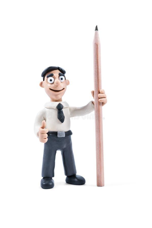 Portrait of a plasticine man with pencil stock image