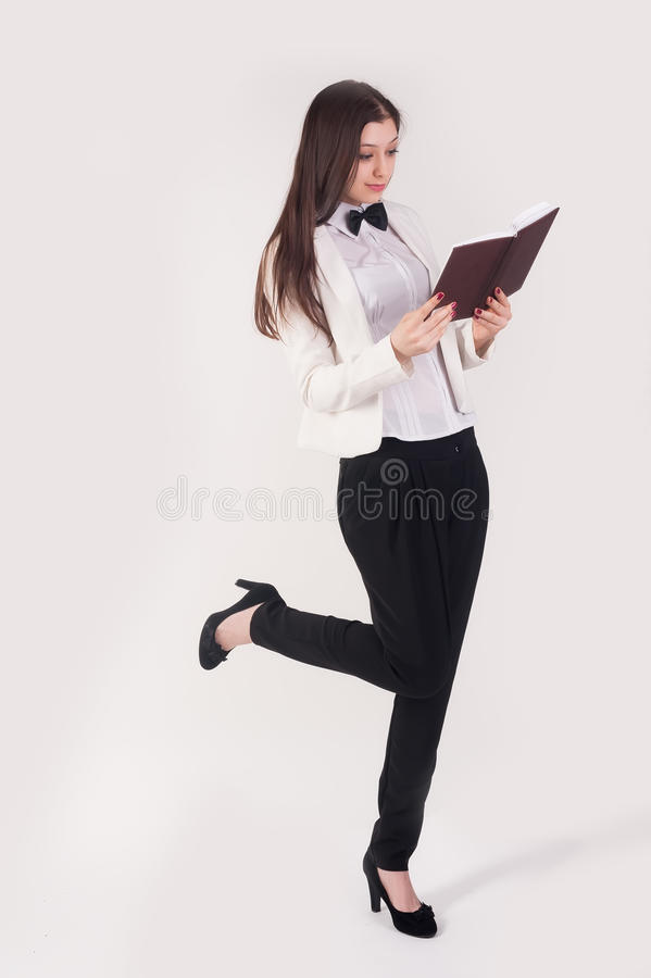 Portrait of playful business woman with organizer royalty free stock photography