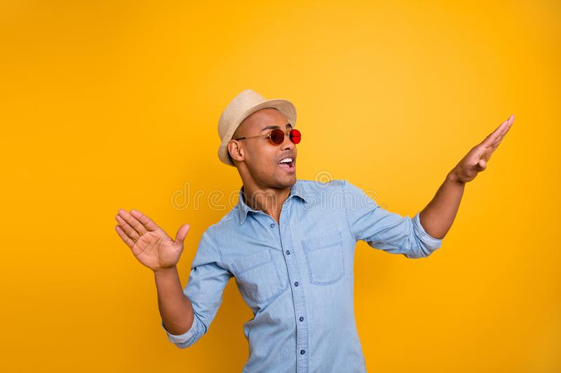 Portrait of playful childish millennial hands palm have eyewear eyeglasses isolated over yellow background. Portrait of playful childish millennial hands palm stock photos
