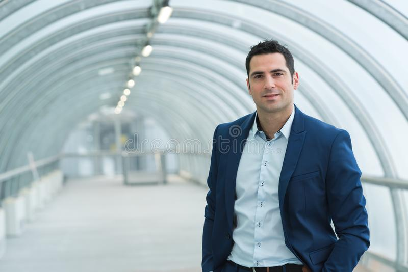 Portrait pleasant businessman standing in building royalty free stock photo