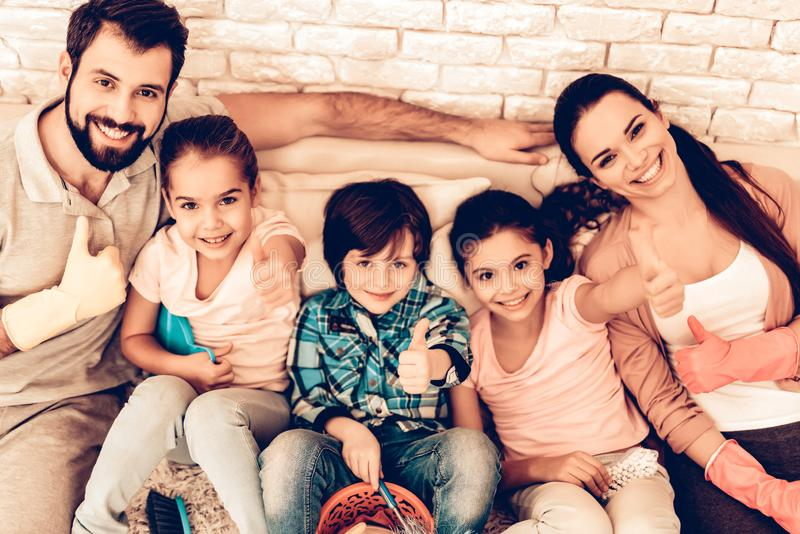 Portrait of Pleased Family After Cleaning Home. royalty free stock image