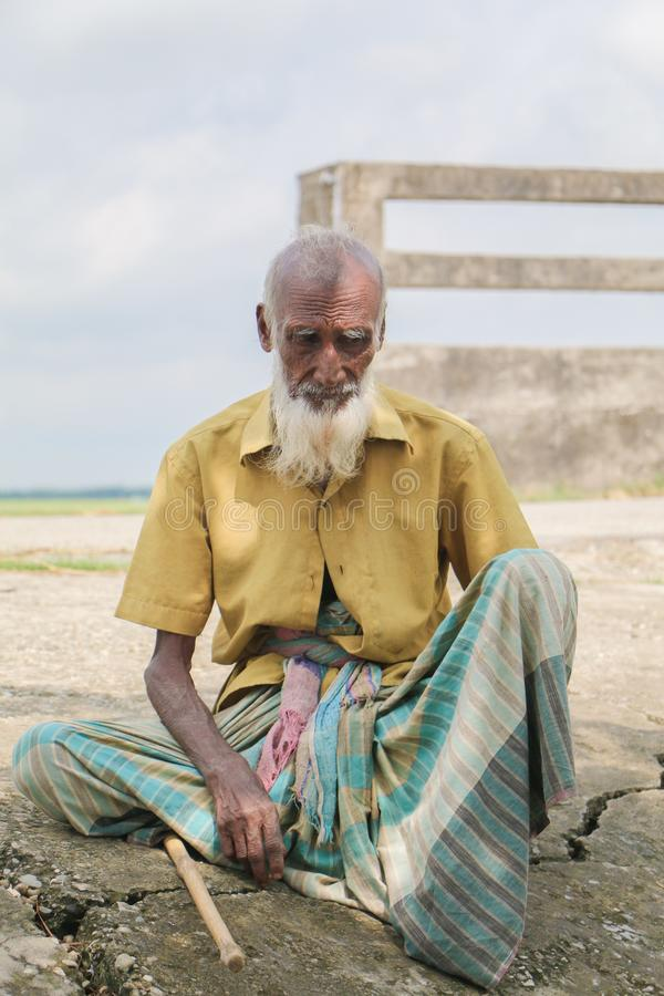 Portrait of a poor aged Bangladeshi man. He is a poor man from Natore, Bangladesh.His age is around 70 to 80 royalty free stock photos