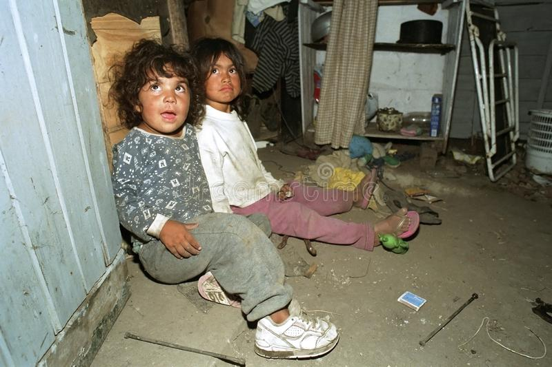 Portrait Poor Argentinian girls playing in slum dwelling royalty free stock photos