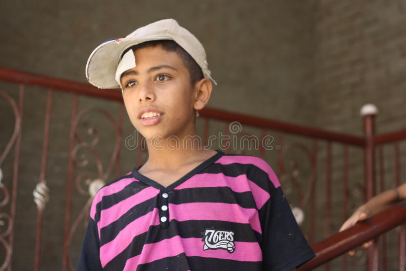 Portrait of a poor boy in the street in giza, egypt. Egyptian face stock photos