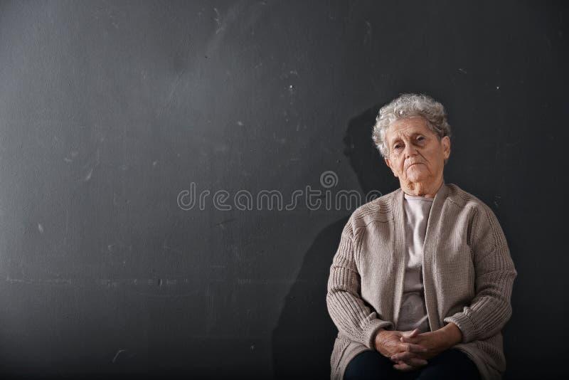 Portrait of poor elderly woman stock photos