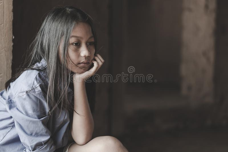 Portrait of a poor little thailand girl lost in deep thoughts, poverty, Poor children. War refugees royalty free stock images