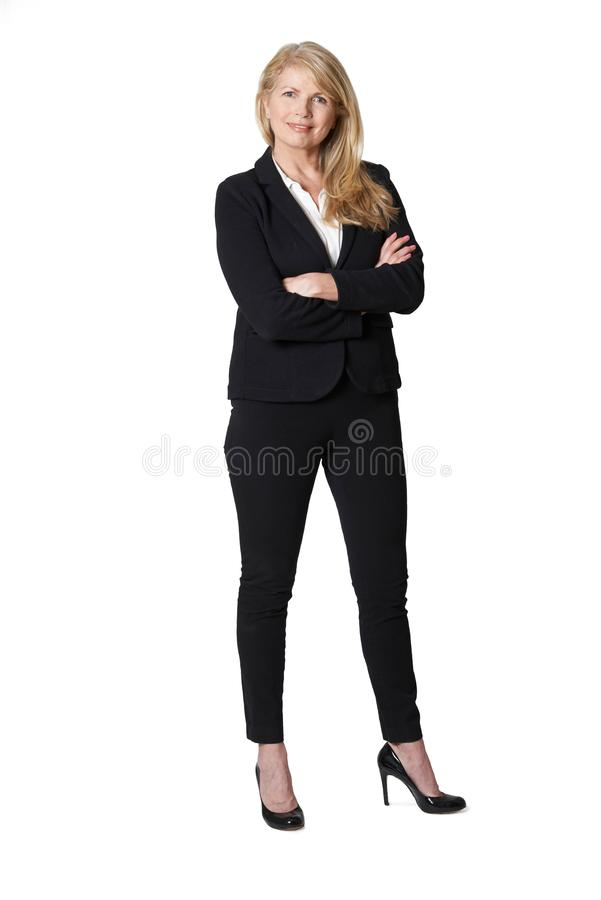 Full Length Portrait Of Portrait Of Mature Businesswoman Against White Background royalty free stock images