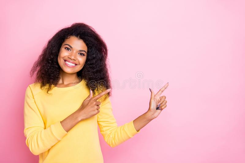 Portrait of positive african girl point index finger recommend promo true promoter show feedback choice decision wear royalty free stock images