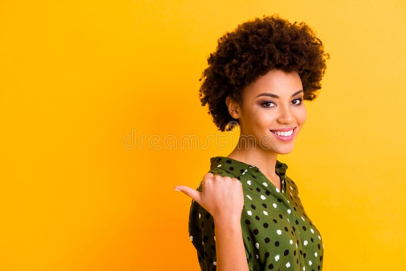 Portrait of positive afro american girl point forefinger copy space present tips pick ads feedback demonstrate choice. Portrait of positive afro american girl stock photos