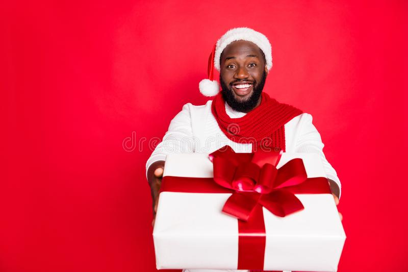 Portrait of positive brown hair afro american man in santa claus cap feel festive enjoy xmas christmas celebration. Portrait of positive brown hair afro american royalty free stock photography