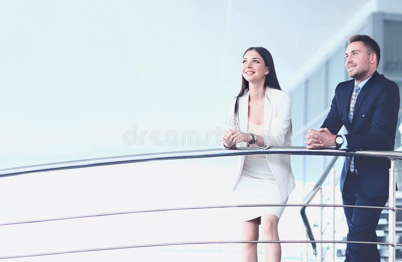 Portrait of positive business group standing on stairs stock photo