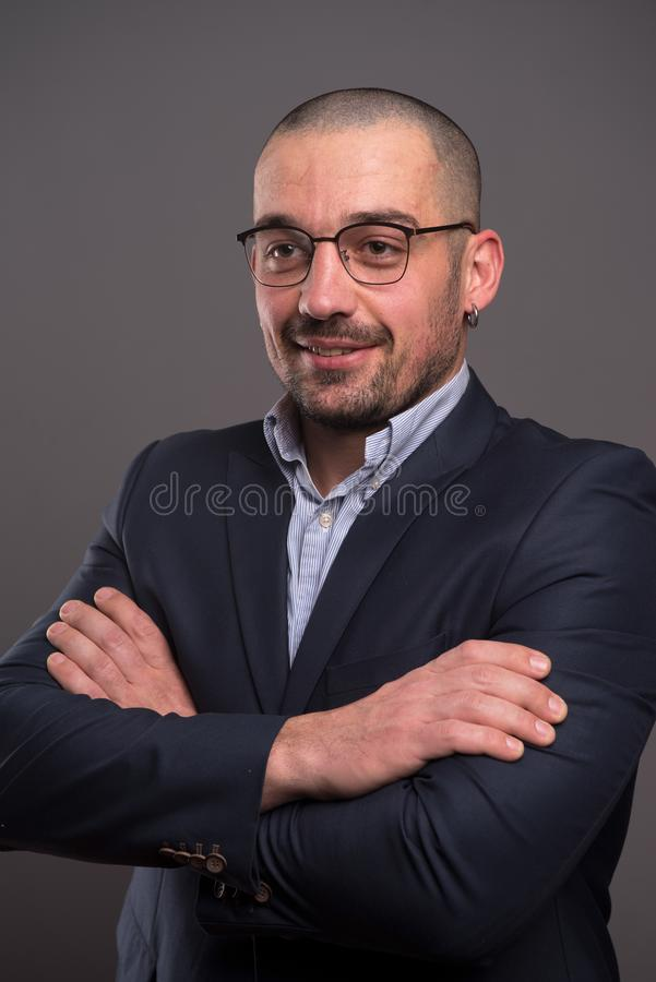 Portrait of positive businessman looking away with his arms crossed royalty free stock photos