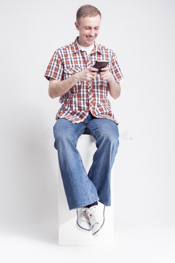 Portrait of Positive Caucasian Man with Handheld Cellphone stock image
