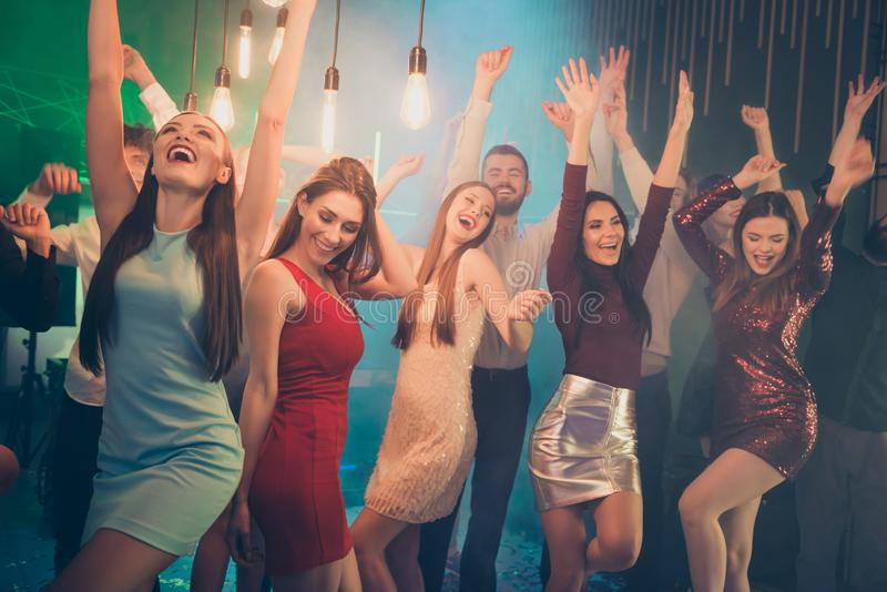 Portrait of positive cheerful buddies couple want have perfect fun holidays go dance club party hard feel rejoice on stock photo