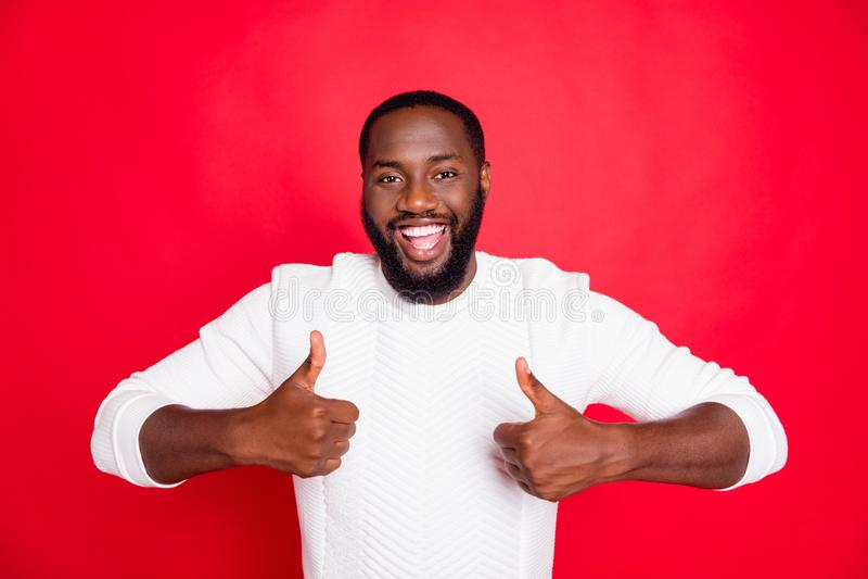 Portrait of positive cheerful dark skin mulatto man show thumb up select suggest ads promo wear good look clothes. Portrait of positive cheerful dark skin stock image